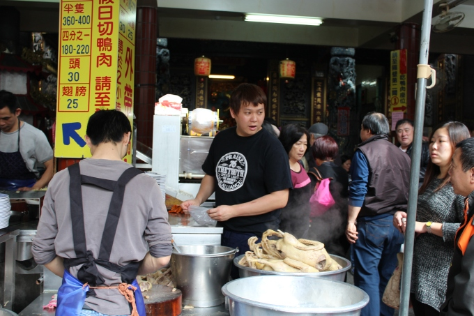 This food stall is literally inside a Buddhist temple